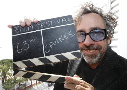Director Tim Burton, Jury President of the 63rd Cannes Film Festival, holds a film clapper in Cannes